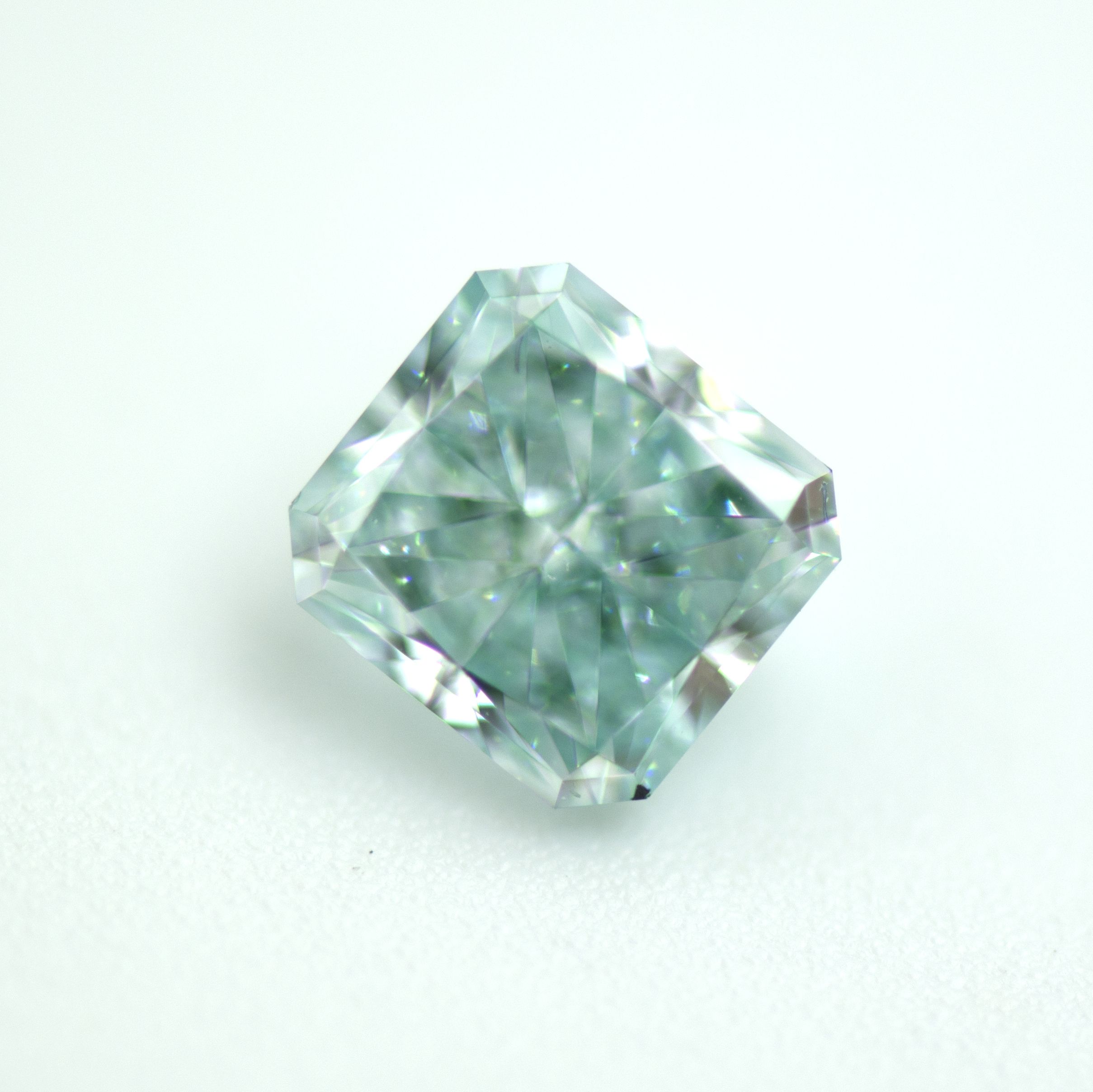 diamond a gem with content when ring gemstones international copper magnification secondary bright under ten its high color article society paraiba blue purple creates than green viewed hues rarer